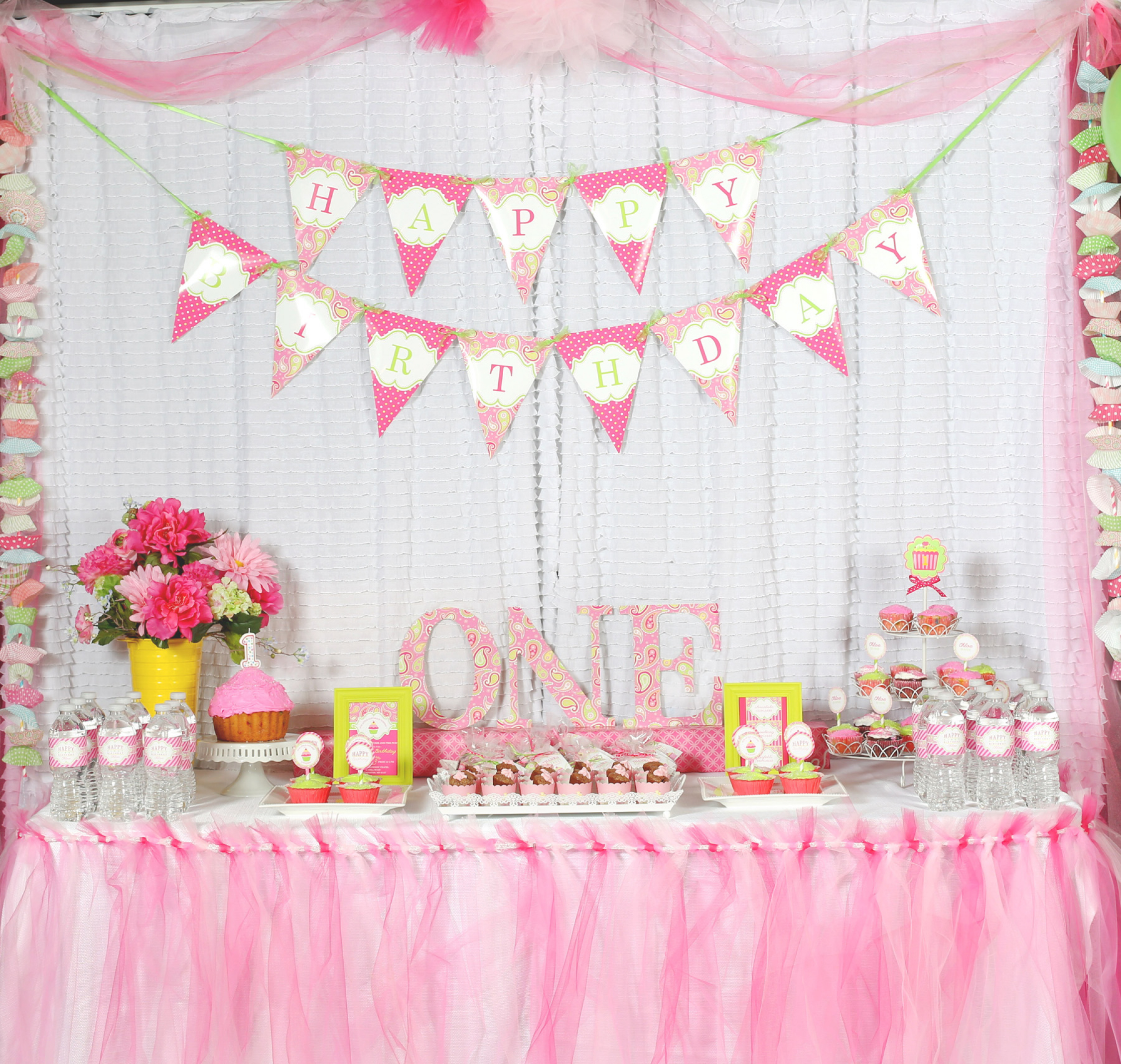 A cupcake themed 1st birthday party with paisley and polka for Baby girl birthday party decoration ideas