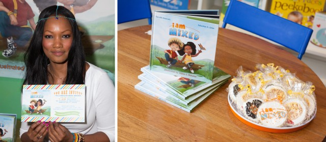 Garcelle Beauvais holding anders ruff custom invitation for I Am Mixed Launch Party