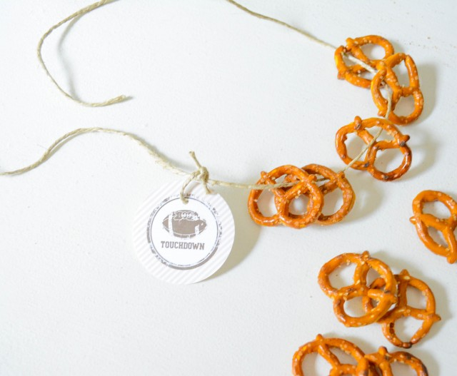 Party logo on pretzel necklace